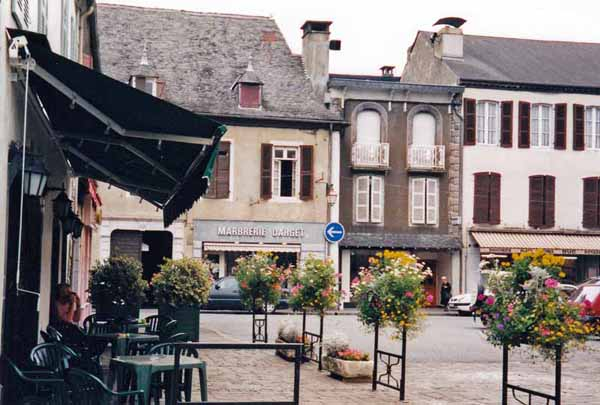 Walking in France: Composing an email over coffee in the cathedral square, Oloron
