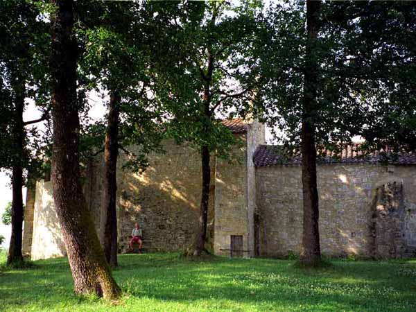 Walking in France: A pilgrim resting at the chapel of Sainte Germaine