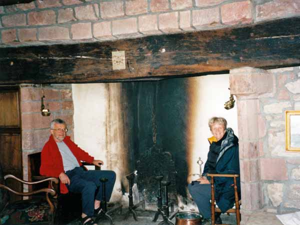 Walking in France: Keith and Penny in the fireplace at Penny's chambre d'hôte