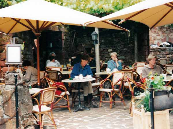 Walking in France: Keeping the diary up-to-date with a warming coffee