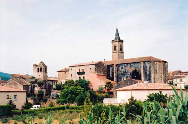 Walking in France: Black slate wall on the church at Hérépian