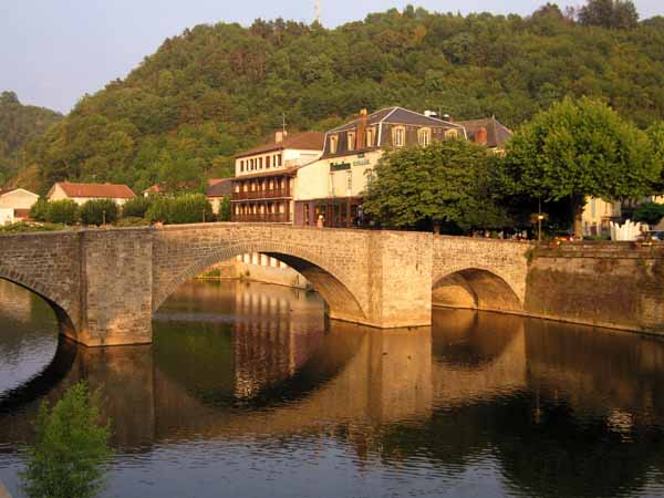 Walking in France: Jenny crossing the Aveyron on the way to dinner
