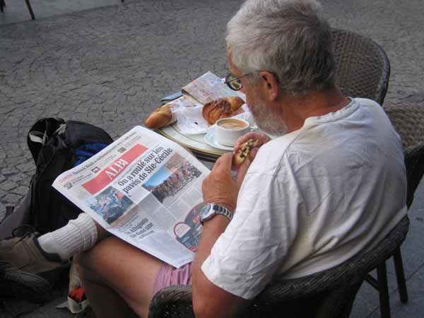 Walking in France: Second breakfast in the Place du Vigan reading about what we had missed yesterday