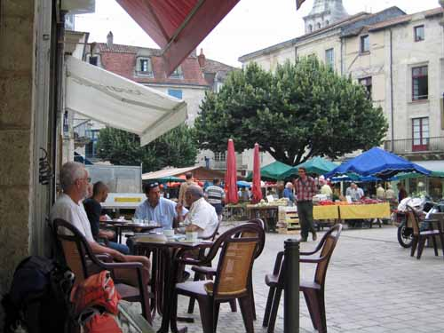 Walking in France: Watching a vegetable market with coffee and croissants