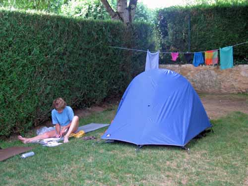 Walking in France: Trying to keep out of the sun at the camping ground