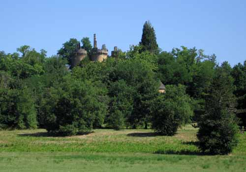 Walking in France: A country house hidden behind some trees that we passed on this very hot day