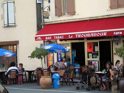 Walking in France: A coffee and a read of the local paper in the main square, Laguépie