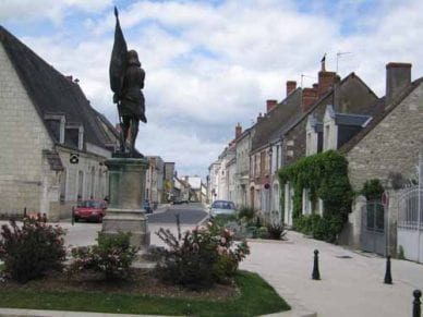 Walking in France: Joan of Arc looking down the main street of Sainte-Catherine-de-Fierbois