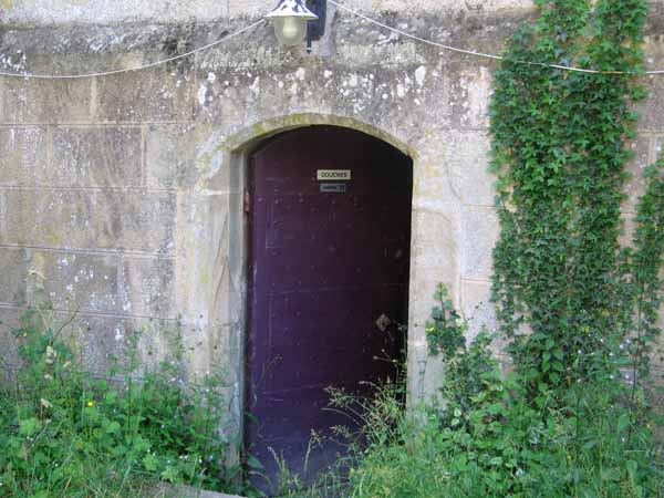 """Walking in France: The """"dungeon"""" entrance to the showers"""