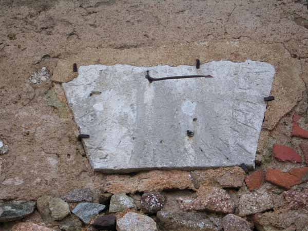 Walking in France: Ancient sundial on the church in Montcimet