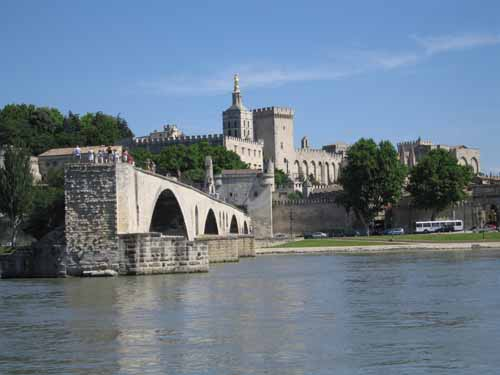 Walking in France: Pont Saint-Bénezet, also known as the Pont d'Avignon, with the Palace of the Popes in the background