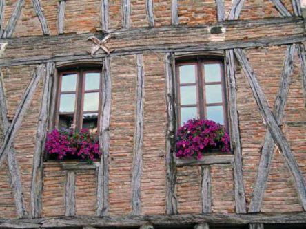 Walking in France: Flower window boxes in the main square, Castelnau-de-Montmiral