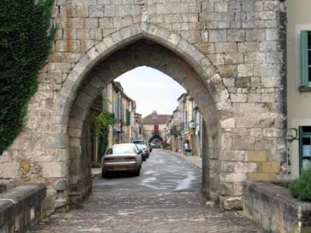 Walking in France: Looking back to the centre of Montpazier through a town gate