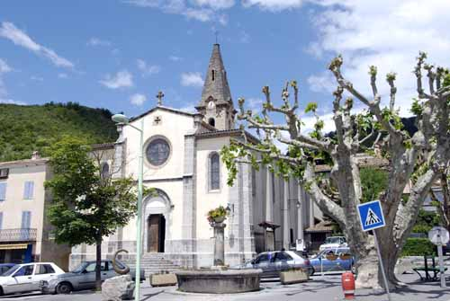 Walking in France: The main square of Barrême, with a tree pruned in the severe French manner