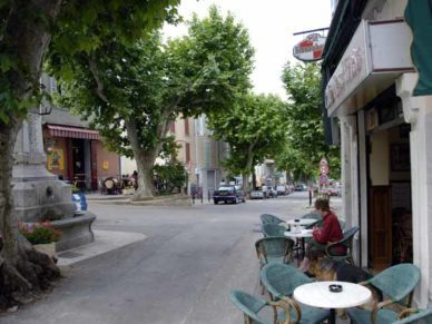 Walking in France: Writing the diary in the central square of Volonne