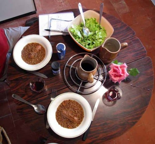 Walking in France: The dinner table - lentils, a sausage, salad from François, red wine and a rose