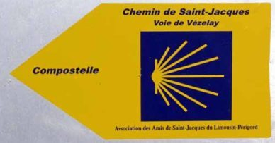 Walking in France: Blue and yellow pilgrimage track marker