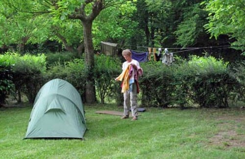 Walking in France: Jenny bringing in her washing, Saint-Astier camping ground