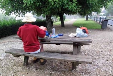 Walking in France: Preparing breakfast in the park near the Bergerac camping ground