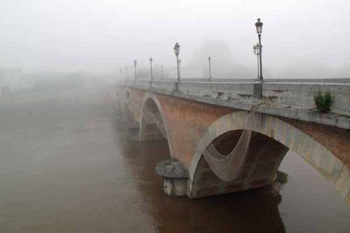Walking in France: Misty bridge over the Dordogne at Bergerac