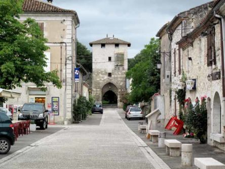 Walking in France: Looking towards a portal from the main square, Vianne