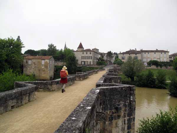 Walking in France: Approaching Barbaste on an ancient foot bridge over the Gélise