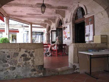 Walking in France: Coffee in an arcade with the worn step, Mézin