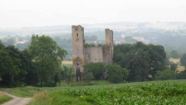 Walking in France: Looking through the drizzle to the ruined château of Tauzia with the towers of Valence on the left
