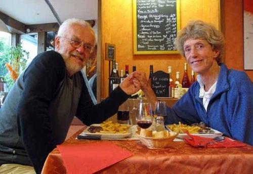 Walking in France: Two happy, warm walkers having dinner