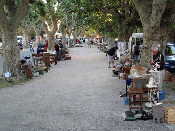 Walking in France: The big street market (vide-grenier) under the trees outside the camping ground, Sainte-Jalle