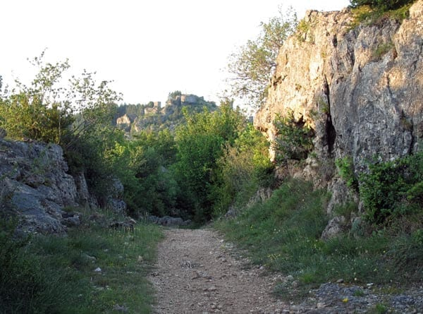 Walking in France: Walking back to the boulangerie, with the ruined fortress on the hill