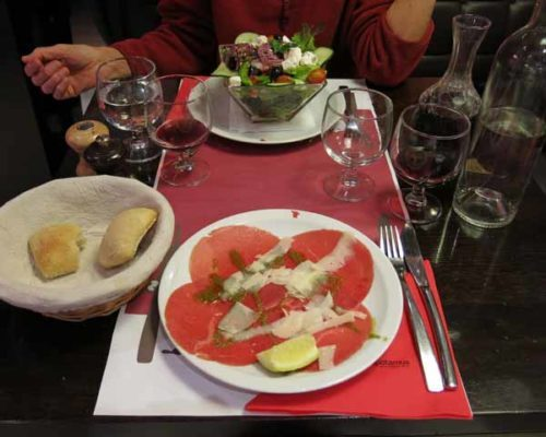Walking in France: Starters at the wonderful Hippo; a salade crétoise and a dish of carpaccio