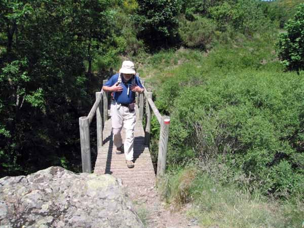 Walking in France: Keith - slightly damaged - crossing the footbridge at the bottom