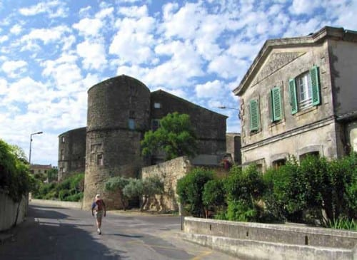 Walking in France: Leaving Générac past the remains of the local château