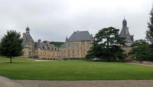 Walking in France: The view of Château de Touffou through locked gates