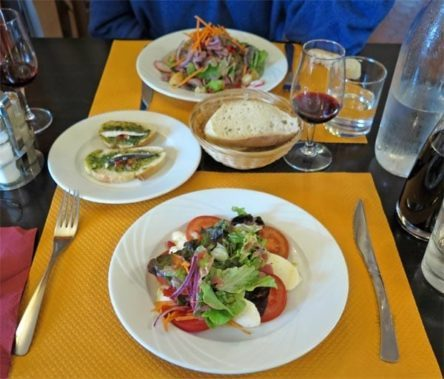 Walking in France: Our mise en bouche of tiny fish with pesto on toast, and our entrees