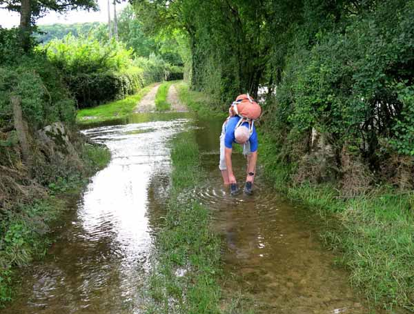 Walking in France: Rinsing our boots in preparation for arriving at our hotel