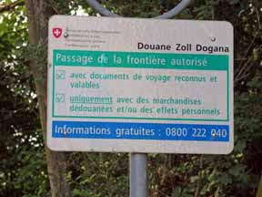Walking in France: Swiss border sign