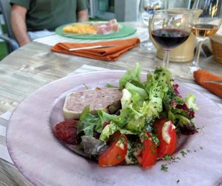 Walking in France: Our entrées; paté and salad, and ham and melon