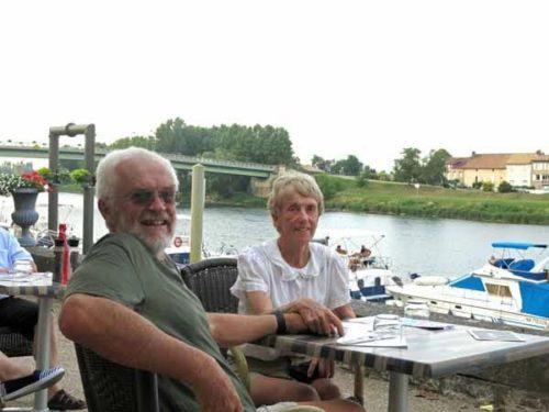 Walking in France: Happy walkers waiting for dinner beside the Saône