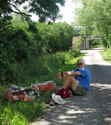 Walking in France: A foot-soldier having a rest, while a TGV passes over the bridge