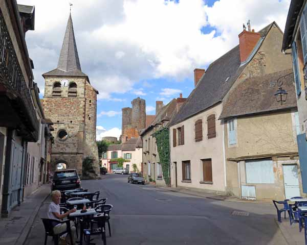 Walking in France: A rosé, with the lonely bell tower behind, and a glimpse ruined of the castle further away, Hérisson