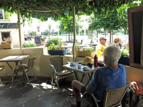Walking in France: A shady bar by the river