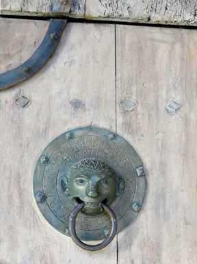 Walking in France: A door knocker on the basilica of St-Julien, Brioude