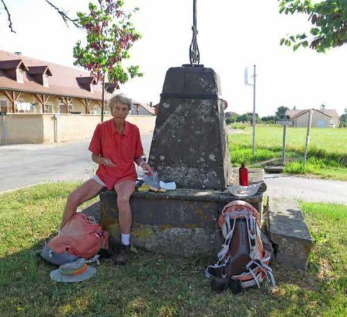 Walking in France: Resting under a wayside cross