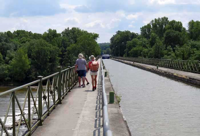 Walking in France: Our final crossing of the Allier, on the pont-canal, with a large boat in the distance